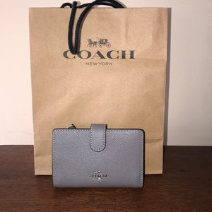Like new Coach wallet. Grey textured leather.